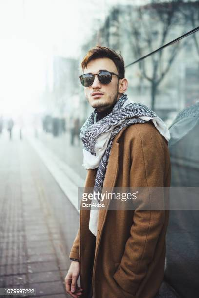 Winter portrait of a young man in the city