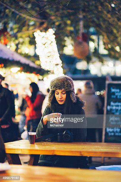 winter portrait of a young woman in town - girls flashing camera stock pictures, royalty-free photos & images