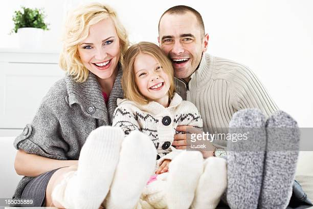 winter portrait of happy family - men in white socks stock photos and pictures