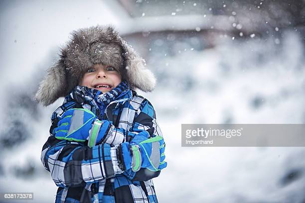 Winter portrait of little boy on a freezing day
