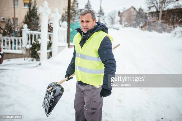 winter problems - snow shovel stock photos and pictures