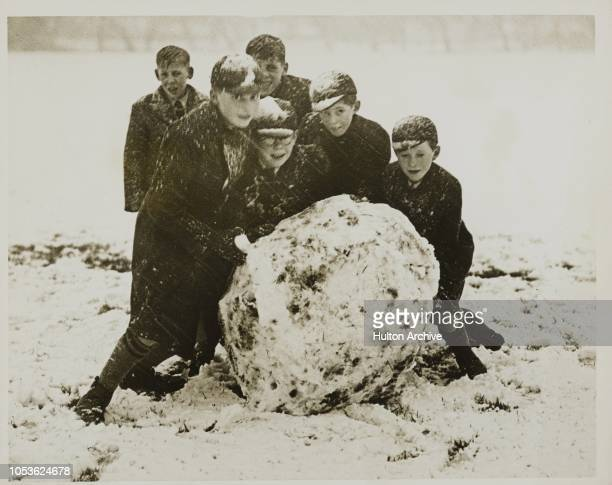 Winter Really Here Rolling a giant snowball on the Rye at High Wycombe Bucks today following a heavy fall of snow High Wycombe Bucks