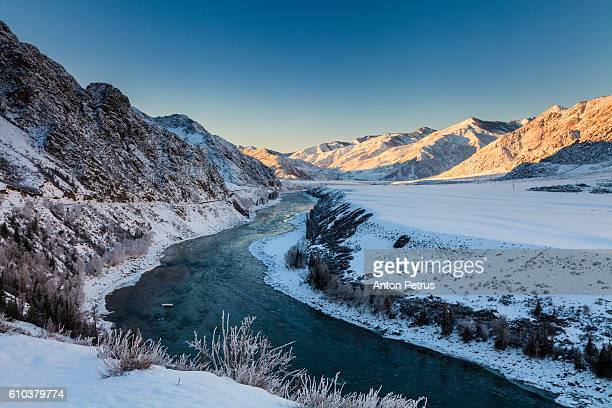winter river in the mountains - summits russia 2015 stock pictures, royalty-free photos & images