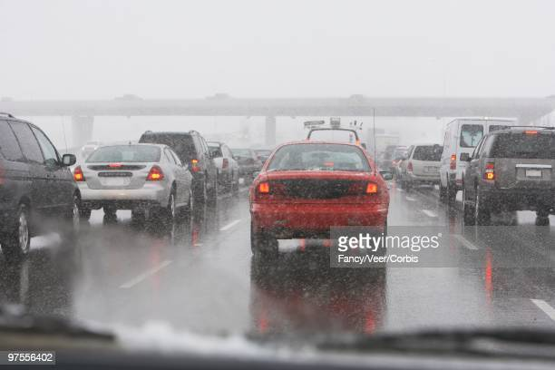 winter road conditions - sleet stock photos and pictures