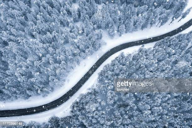 winter road - summit stock pictures, royalty-free photos & images