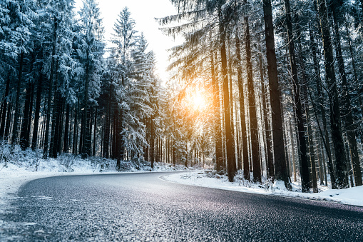 Winter road through the forest 1060861642