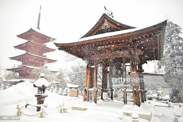Winter scene of a Japanese pagoda and bell covered with snow. This photo was taken in Hirosaki in northern Japan.