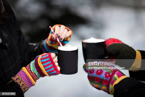 winter scene of hot cocoa and girls hands in mittens - mitten stock pictures, royalty-free photos & images