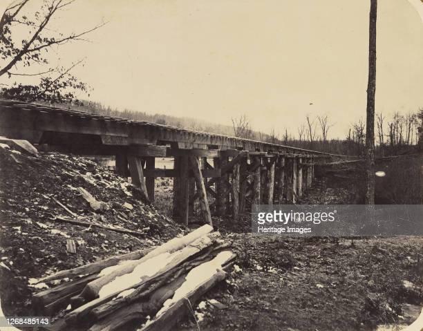 Winter Scene with Trestle Bridge Along the Atlantic Great Western Railway 186264 Artist James Fitzallen Ryder