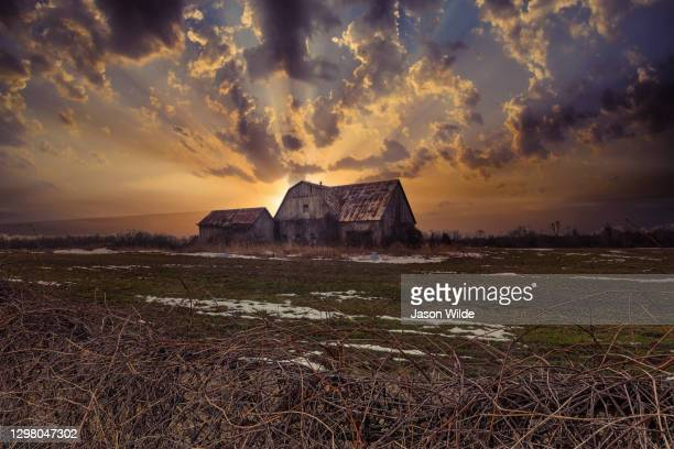 winter scenic landscapes of rural farm land in south eastern ontario canada.  featuring fields, barns, and general big sky scenes with snow and ice. - canada stock pictures, royalty-free photos & images