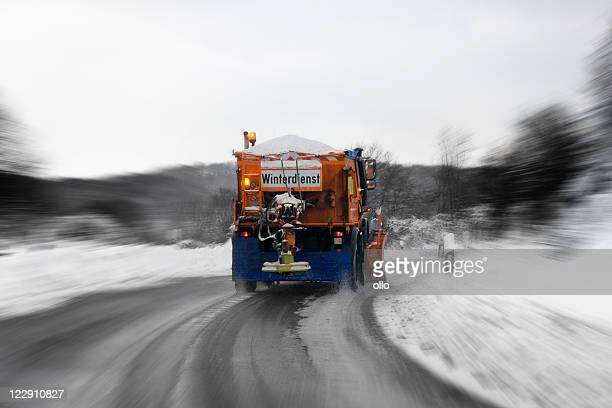 winter service in action - bad road conditions - road salt stock pictures, royalty-free photos & images