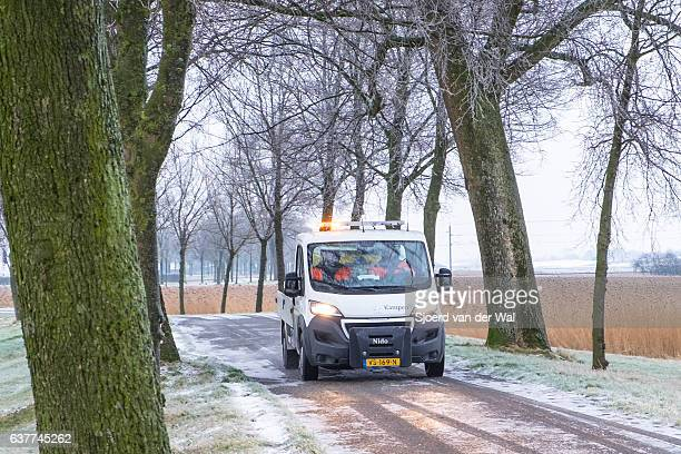 Winter service vehicle truck clearing road of snow and ice