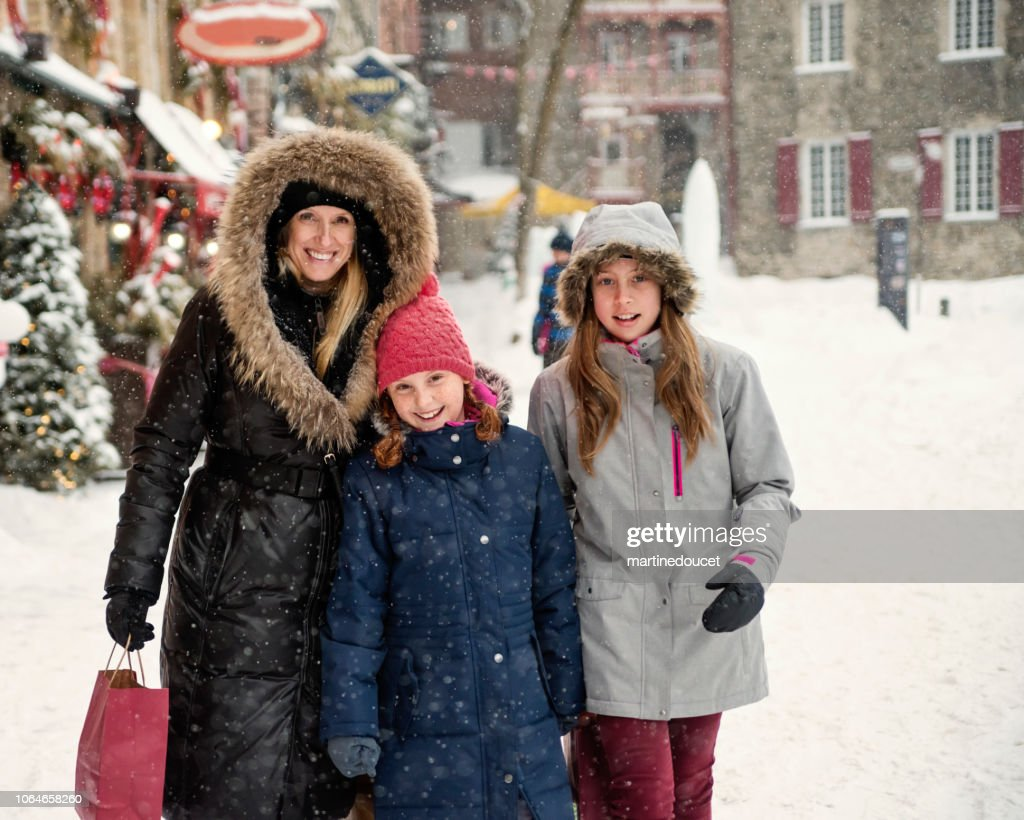Winter shopping for mother and preteen girls. : Stock Photo
