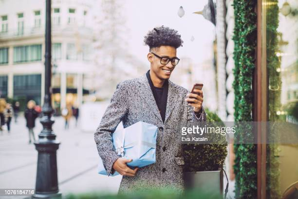 winter shopping - man shopping stock pictures, royalty-free photos & images