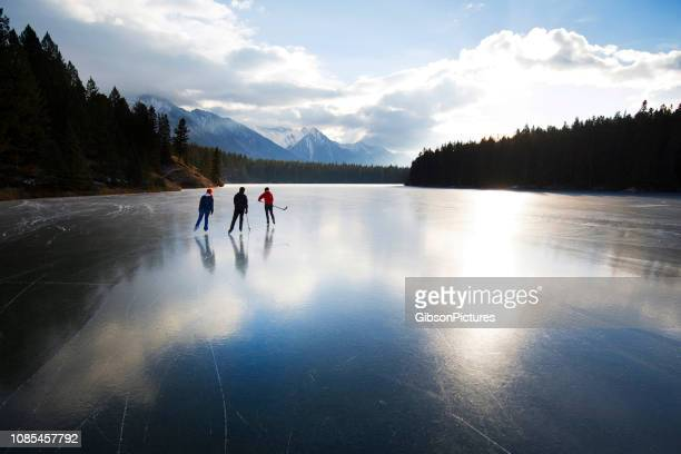 winter skating in banff national park - alberta stock pictures, royalty-free photos & images