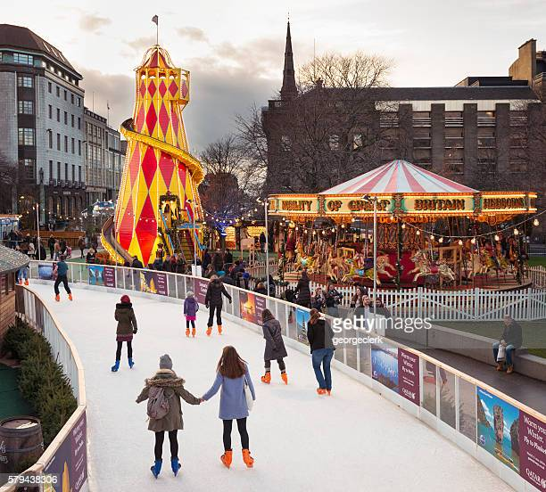 winter skating in central edinburgh, scotland - ice rink stock photos and pictures