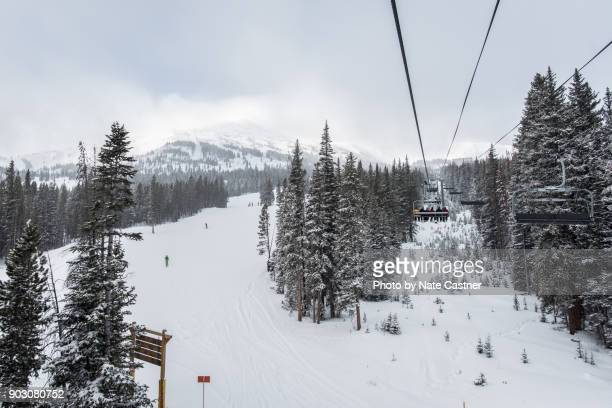 winter skiing and snowboarding in colorado - alpine skiing stock pictures, royalty-free photos & images