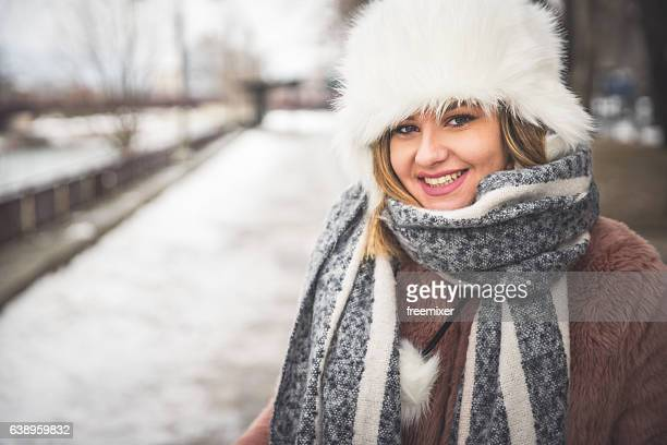 winter smile - fur hat stock photos and pictures