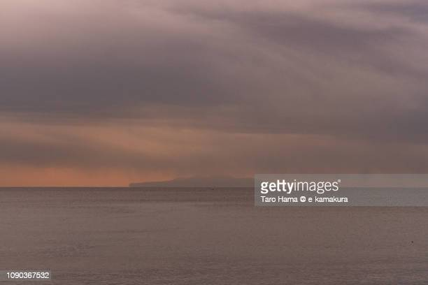 Winter snow clouds on Oshima Island in Tokyo and Sagami Bay, Northern Pacific Ocean in Japan