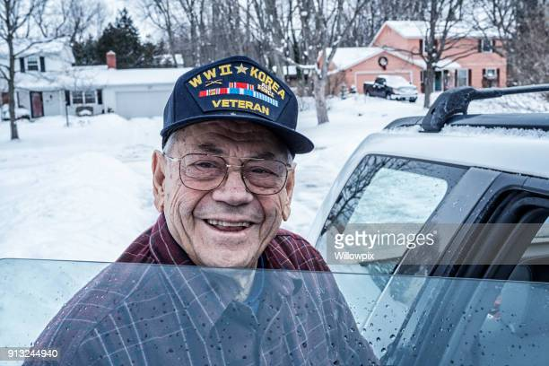 winter snow smiling wwii and korean war military veteran - veterans day stock photos and pictures