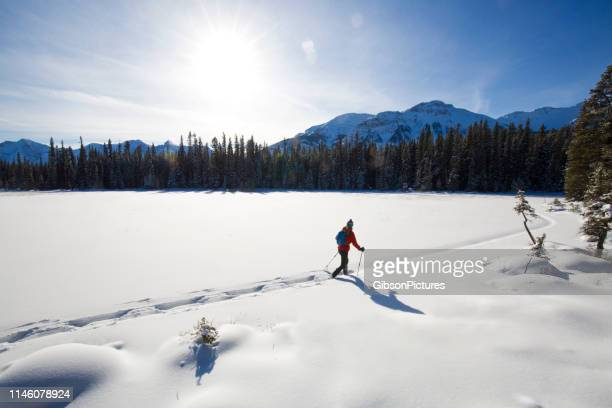 winter snowshoe adventure - winter sport stock pictures, royalty-free photos & images