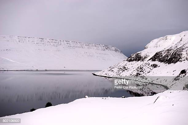 winter snowy fjord landscape at dyrafjordur in westfjords of iceland - küste stock-fotos und bilder