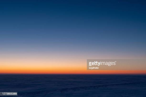 winter snowy sunrise - sunrise dawn stock pictures, royalty-free photos & images