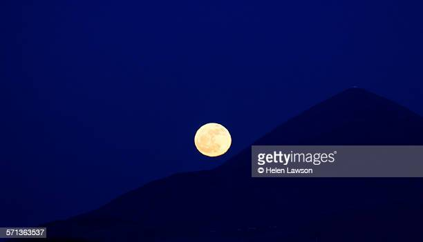 Winter Solstice moon rolling up Croagh Patrick