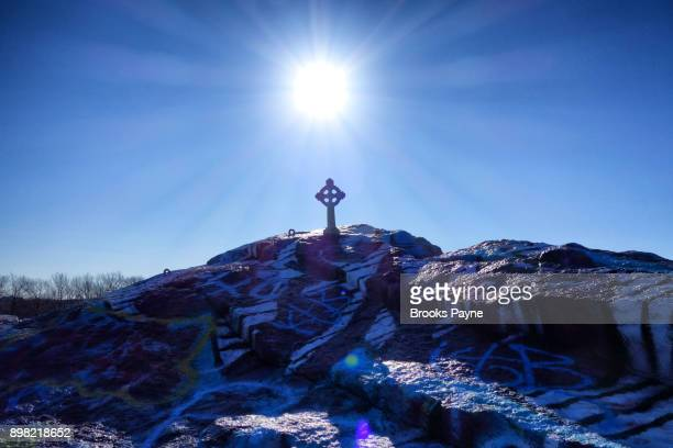Winter Solstice with Celtic Cross atop Quincy Quarries