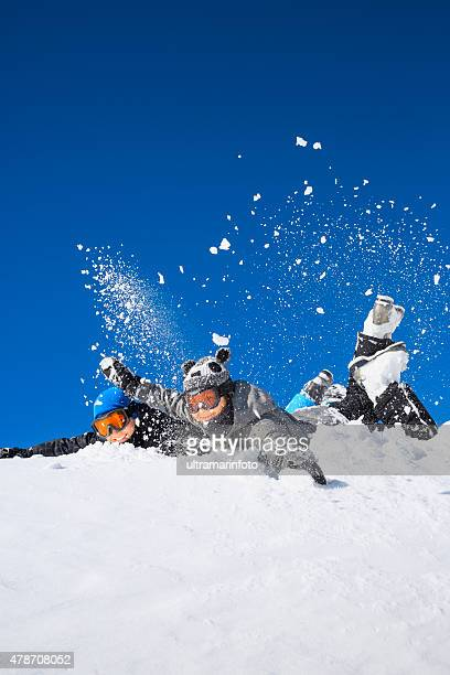 Winter sport  playing  Teenager boy and girl snow skiers enjoying