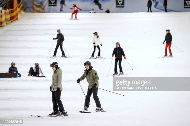 Winter sports enthusiasts ski on the slopes of Zoetermeer on November 15 amid the Covid-19 pandemic, caused by the novel coronavirus. - Winter...