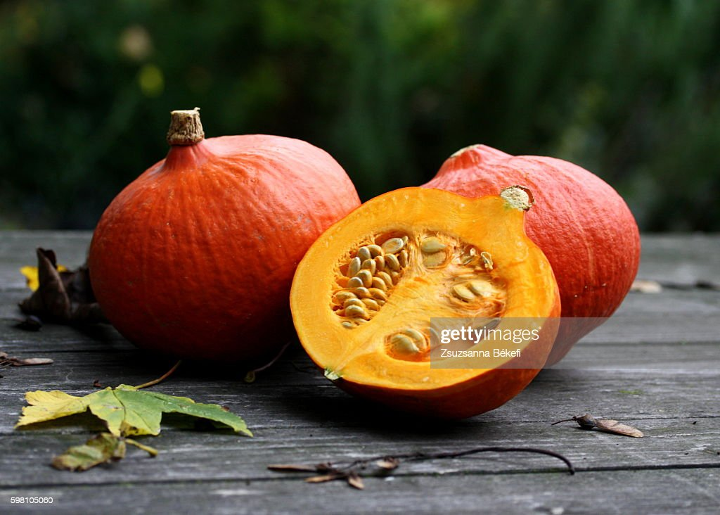 winter squashes on a garden table with autumn leaves : Stock Photo