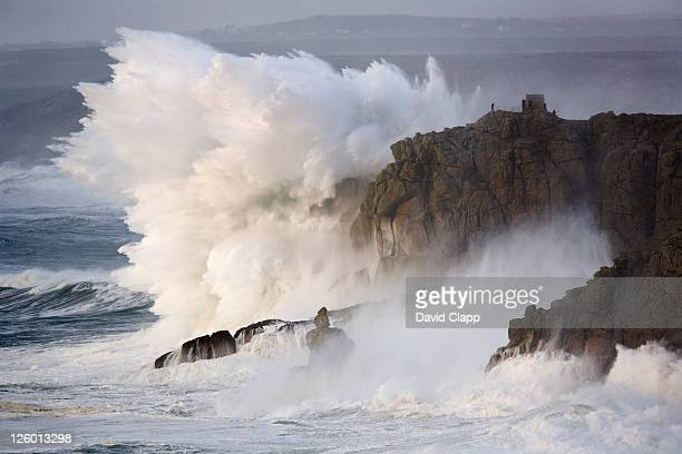 winter storms hit the rocky coastline with monumental force at land's end in cornwall. - rough stock pictures, royalty-free photos & images