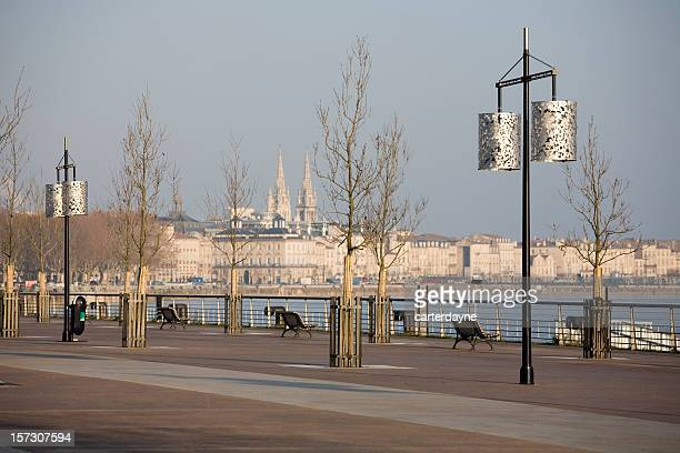 Winter sunrise and shadows on Bordeaux promenade, France