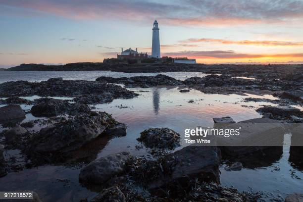 Winter sunrise at St Mary's Lighthouse on February 12, 2018 in Whitley Bay, England. The lighthouse was built in 1898 and remained operational until...
