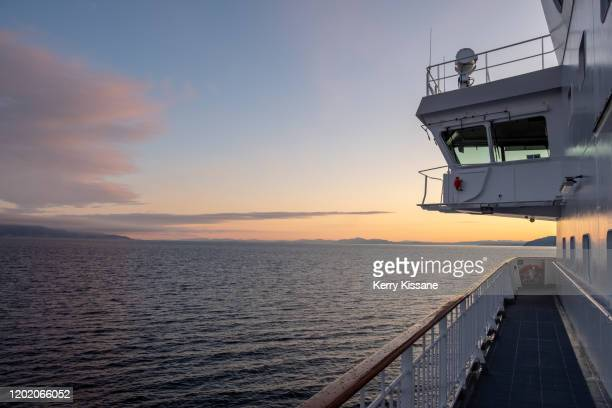winter sunrise in norway - ponte di una nave foto e immagini stock