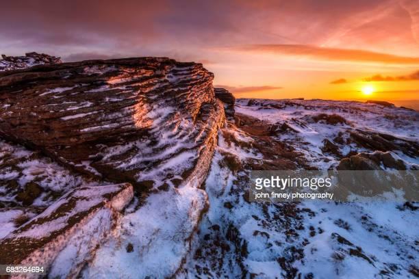 Winter sunrise on Kinda Scout in the English Peak District. UK.