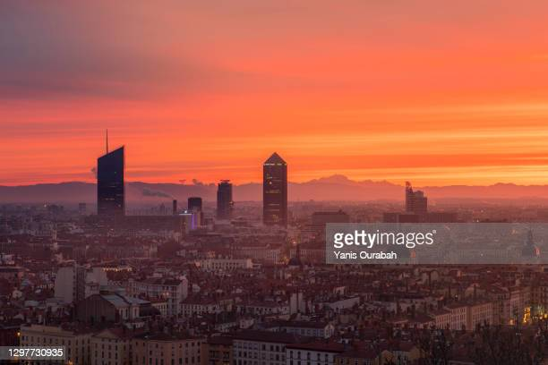winter sunrise over the city of lyon, france, with mont-blanc and the alps in the backrgound - lyon stock pictures, royalty-free photos & images