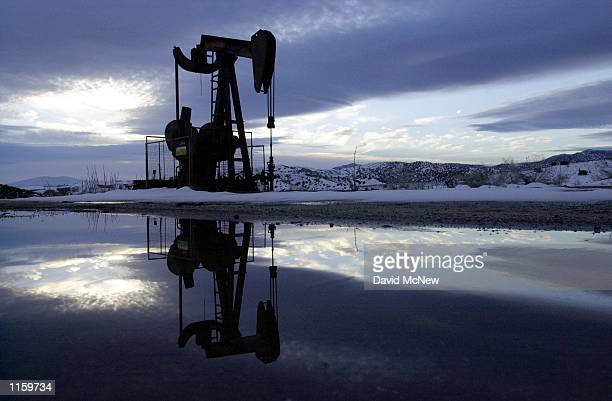 A winter sunrise surrounds an oil well in the South Cuyama Oil Field February 16 near New Cuyama CA in Santa Barbara County In recent months the...