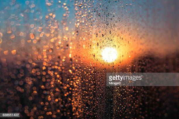 Winter Sunrise with Condensation Water Dew on Window