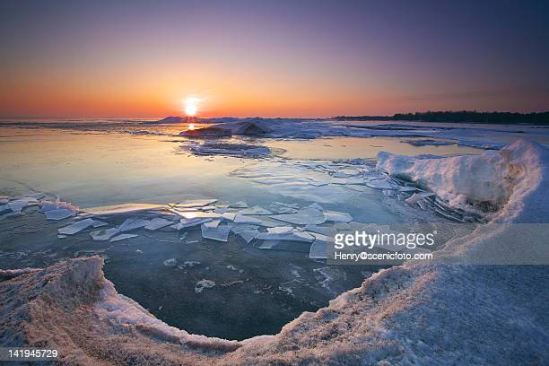winter sunset at lake huron - midland michigan stock pictures, royalty-free photos & images