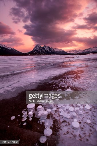 A winter sunset at Preachers Point on Abraham Lake, Kootenay Plains, Alberta, Canada