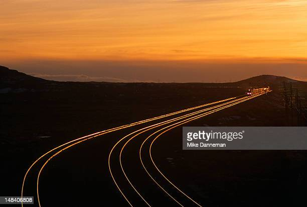 winter sunset at railway lines - cargo train stock photos and pictures
