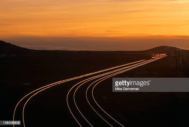 winter sunset at railway lines - 貨物列車 ストックフォトと画像