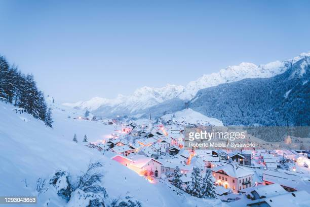 winter sunset on ardez covered with snow, switzerland - switzerland stock pictures, royalty-free photos & images