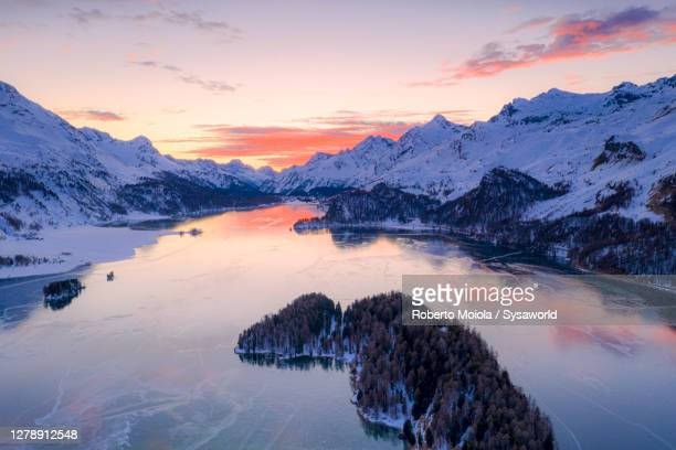 winter sunset on lake sils and snowy mountains, switzerland - switzerland stock pictures, royalty-free photos & images
