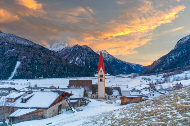 Winter sunset on village and mountains, Valle Isarco, Alto Adige, Italy