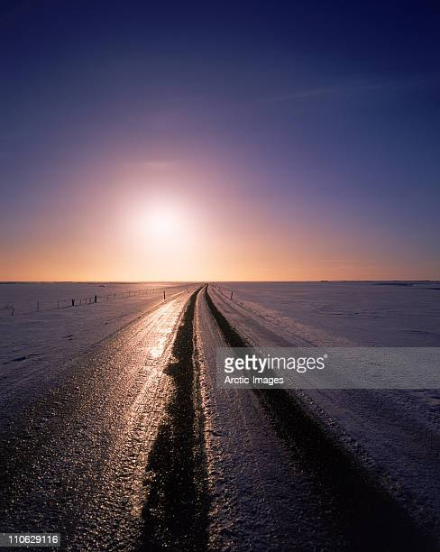 Winter sunset over icy road