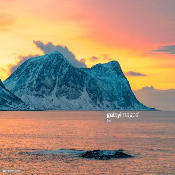 Winter sunset over Senja Island in the Norwegian Sea in Northern Norway