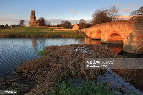 winter sunset, st marys church, river nene, fotheringhay village - northamptonshire stock pictures, royalty-free photos & images